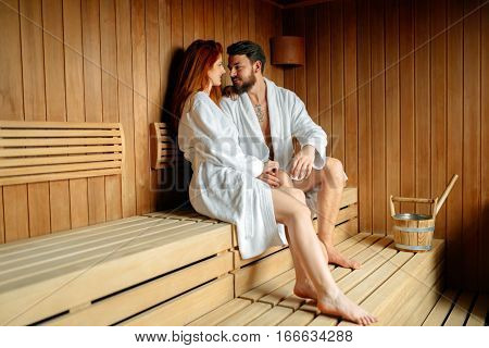 Couple Enjoying Finnish Sauna