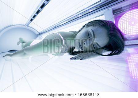 Beautiful Woman Lying In Solarium