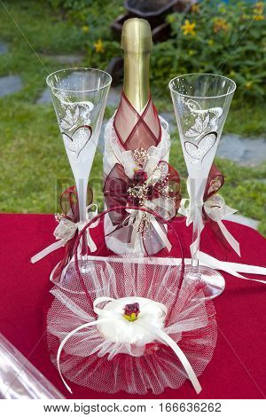 cold champagne and beautiful white cups wedding