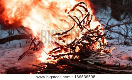 wires on fire. Firing winding insulation of electrical wiring in the fire in the winter woods