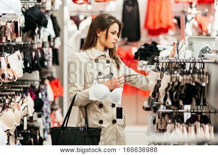 Beautiful cute woman shopping lingerie and underware