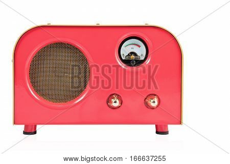 Small red retro speaker with the controls and detector isolated on a white background