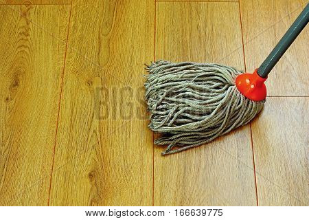 washing the wooden floor with wet mop