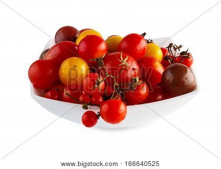 Plenty of Yellow pea, cherry and plum tomato sorts isolated on white background. Closeup pile of ideal sweet vegetables in bowl, healthy natural organic food