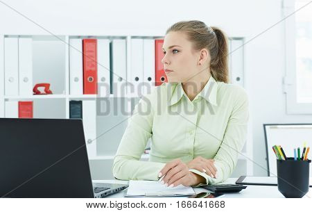 Beautiful young secretary lost in thought at work in the office. Business exchange market job offer analytics research excellent education certified public accountant concept