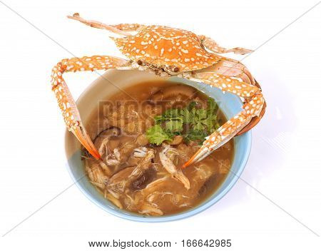 Braised fish maw in red gravy abalone mushroom with crab meat The presentation of the more interesting and difference on with steamed crab was placed on top White background have little nice shadow.