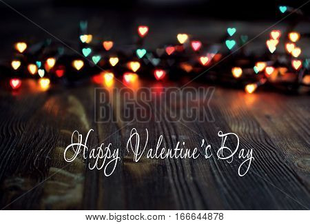 variegated heart bokeh, Valentine's day concept on wooden background, greeting card