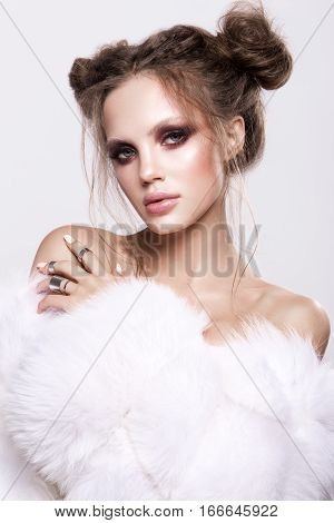 Beautifful european brunet woomen with gloss clean healfy skin, glooss shiny pastel pink lipstik and with trendy fashion hairstyle in white fluffy fur coat poster