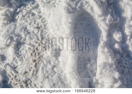 Footprints in the snow. Man's shoe print.