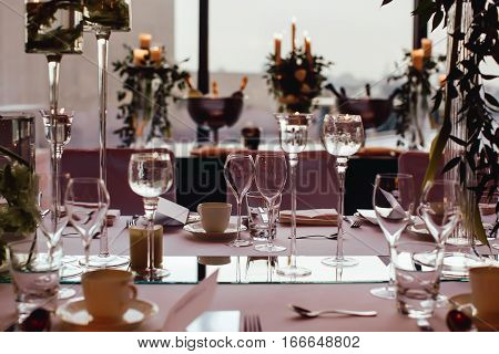Table setting before dinner catering table set service with silverware, napkin and glass at restaurant before party