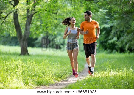 Healthy Fit Couple Running In Nature