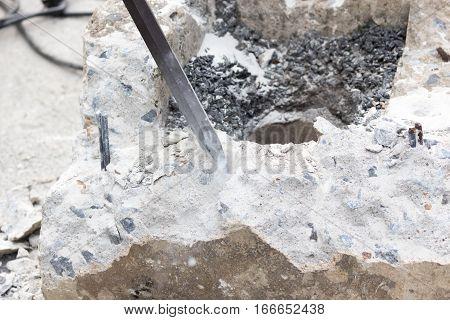 Construction worker removes excess concrete ,Drilling hole into concrete