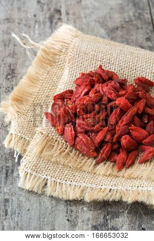 Wolfberries or Goji berries on wooden table