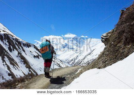 Lonely hiker trekking in Himalaya Mountains, Annapurna Circuit Trek, Nepal