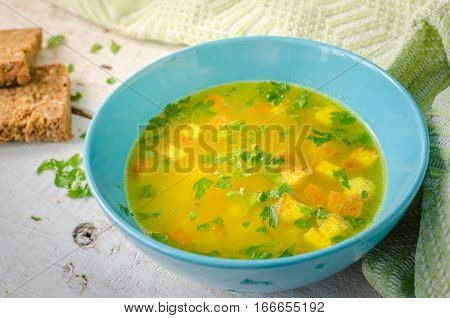 Zuppa Imperiale - Italian soup with eggs and Parmesan cheese dish of Emilia Romagna. Imperial soup on wooden table. Omelet in chicken broth with parsley in a bowl. Italian cuisine concept. poster