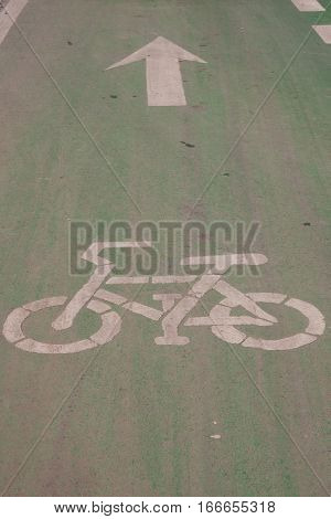 The bicycle way symbol paint on asphalt road surface