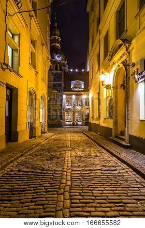RIGA LATVIA - 1ST JAN 2017: A view along streets in Riga towards the Riga Dome Cathedral at night.