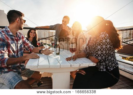 Young People Having Rooftop Party In Evening.