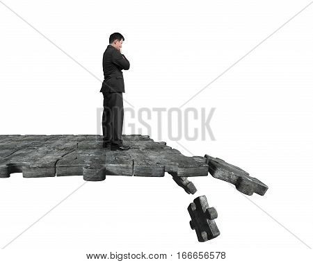 Thinking Man Standing On Breaking Puzzle Ground
