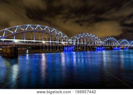 RIGA LATVIA - 2ND JAN 2017: The Railway Bridge in Riga at night crossing the Daugava River