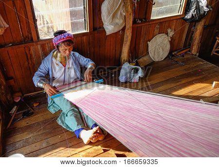 Kayan Woman Weaving Bright Green Silk Fabric