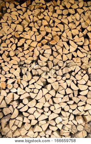 wall firewood Background of dry chopped firewood logs in a pile