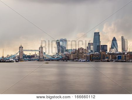 LONDON UK - 25TH MARCH 2015: A view towards Tower Bridge and the City of London. Lots of skyscrapers and other buildings can be seen.