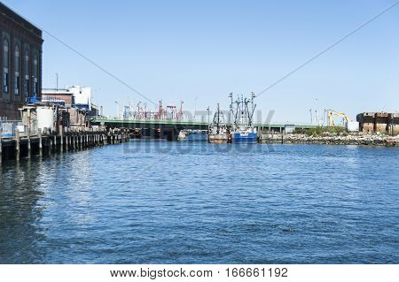 New Bedford Massachusetts USA - September 25 2016: Fishing boats moored along New Bedford waterfront on quiet weekend