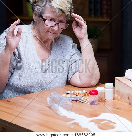 Sad Senior Woman With Medicines