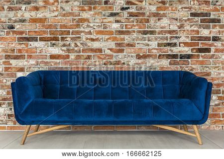Brick Wall And Blue Sofa