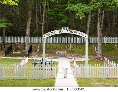 MACKINAC ISLAND, MI - JULY, 2016: Fort Mackinac cemetery in the back woods of the island.