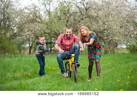 Father Teaching Son To Ride A Bike By His Example