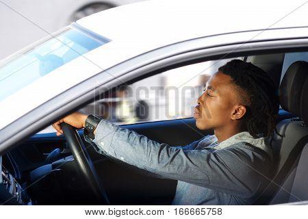 Young Black Man Driving Car