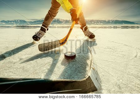 Ice hockey game on the frozen lake moment