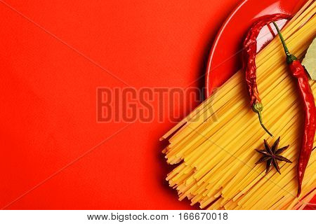 Cooking Pasta With Chili Pepper And Badian On Red Background