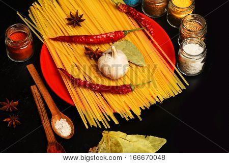 Cooking Pasta With Spice, Chili Pepper, Garlic And Badian