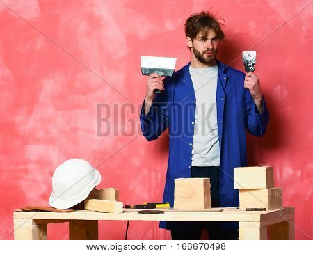 Builder Man Holding Putty Knife