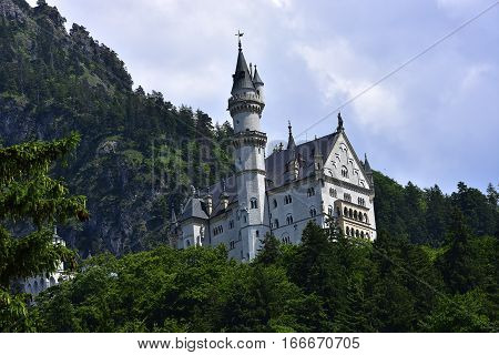 Neuschwanstein Castle with the mountains in the background.