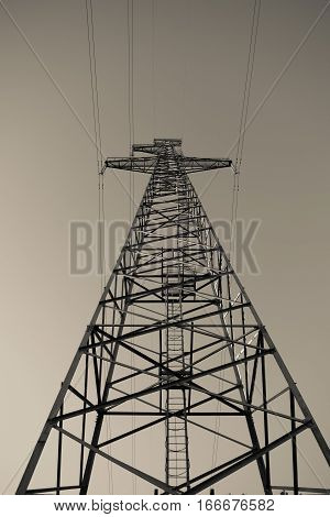 Pylon of powerline in the middle of meadow
