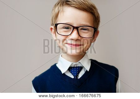 Portrait a boy in school uniform. Education. Objects over white.