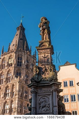 Cologne, Germany - January 19, 2017: Tower City Hall. At the Town Hall Square are all great celebrations and Cologne event. The foreground fragment of the fountain-monument of Jan von Werth.