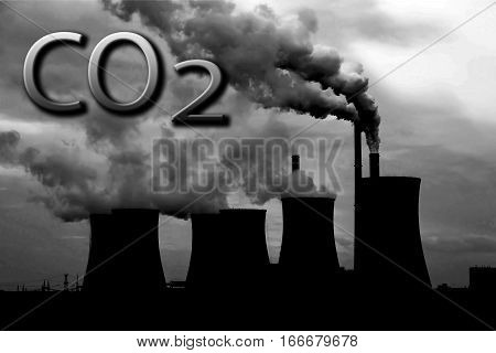 Smoke of chimney writing CO2 in the sky