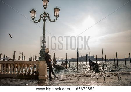 Blonde pregnant woman with wonderful Venice landscape