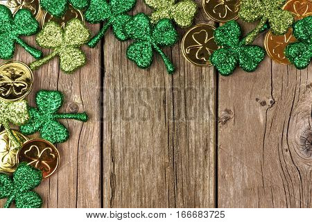 St Patricks Day Corner Border Of Shamrocks And Gold Coins Over A Rustic Wood Background