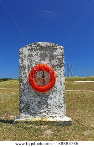 Rescue ring on a concrete base on the coast of Brittany Finistere France