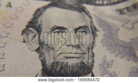 Closeup of Abraham Lincoln on American Five Dollar Bill