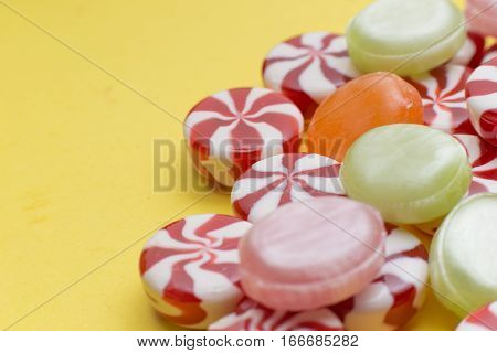 Candies Colorful Mix On Yellow Bright Background With Copy Space.