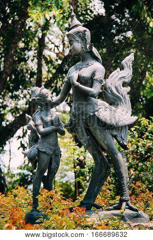 Kid Praying to Woman Statue which looks alike Myth Giant Bird God