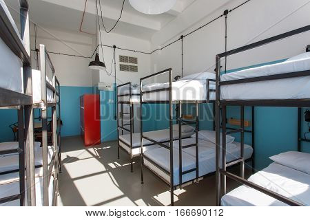 Big space of students bedroom without people inside a hostel for backpackers and university learner.