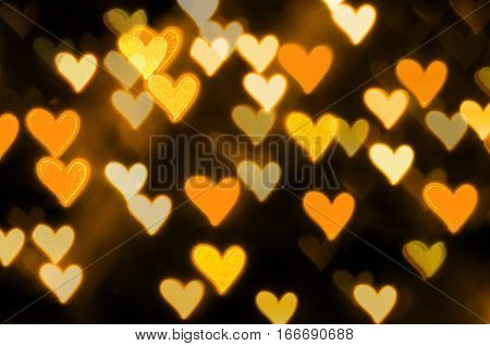 St Valentines Day golden heart bokeh background - St Valentines day abstract light background with gold light hearts. St Valentines day concept